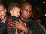 Mandatory Credit: Photo by LAURENTVU/SIPA/REX Shutterstock (4116187e).. Kanye West with daughter North West.. Balenciaga show, Spring Summer 2015, Paris Fashion Week, France - 24 Sep 2014.. ..