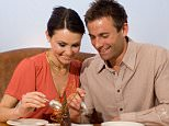 Couple eating in a restaurant flirting. Image shot 2005. Exact date unknown. AE7TD0