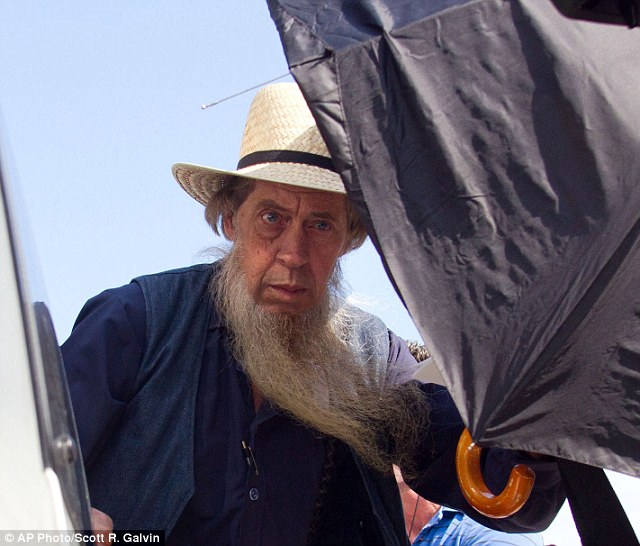 An Amish man gets into his vehicle outside the US Federal Courthouse in Cleveland yesterday