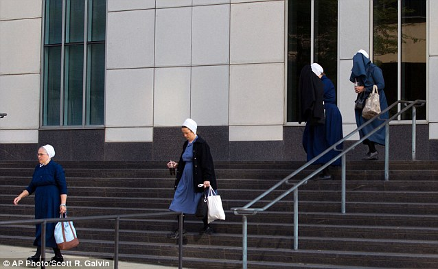 Amish women exit the US Federal Courthouse in Cleveland yesterday