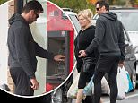 Hugh Jackman and his wife Deborra-Lee Furness spotted out in Melbourne...The couple were seen going to a fitness centre together before doing a morning shop, dropping into the butchers and a green grocers...The couple were dressed similar, with both wearing black gym clothes.....Pictured: Hugh Jackman and Deborra-Lee Furness..Ref: SPL1052152  160615  ..Picture by: Splash News....Splash News and Pictures..Los Angeles: 310-821-2666..New York: 212-619-2666..London: 870-934-2666..photodesk@splashnews.com..