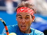 LONDON, ENGLAND - JUNE 16:  Rafael Nadal of Spain plays a backhand in his men's singles first round match against Alexandr Dolgopolov of Ukraine during day two of the Aegon Championships at Queen's Club on June 16, 2015 in London, England.  (Photo by Julian Finney/Getty Images)