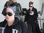Please contact X17 before any use of these exclusive photos - x17@x17agency.com   Khloe Kardashian looks tough in her black bandana as she arrives at her early morning workout in Beverly Hills. June 16, 2015  X17online.com EXCLUSIVE