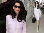 15.JUNE.2015 - LONDON - UK *EXCLUSIVE PICTURES* GEORGE CLOONEY'S WIFE AMAL CLOONEY LOOKING ELEGANT WEARING A MATCHING SKIRT AND JACKET, DARK SUNGLASSES WHILE CARRYING A BLACK LEATHER HANDBAG AND A IPHONE WITH A PINK CASE. THE LAWYER WAS WALKING DOWN SHEPHERD MARKET IN LONDON AND SEEN GETTING INTO A CAR. BYLINE MUST READ : XPOSUREPHOTOS.COM ***UK CLIENTS - PICTURES CONTAINING CHILDREN PLEASE PIXELATE FACE PRIOR TO PUBLICATION *** **UK CLIENTS MUST CALL PRIOR TO TV OR ONLINE USAGE PLEASE TELEPHONE 0208 344 2007**