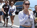 Kelly Brook and her boyfriend Jeremy Parisi are seen on holiday on June 16, 2015 in Taormina, Italy.  Pictured: Kelly Brook and Jeremy Parisi Ref: SPL1052364  160615   Picture by: Splash News  Splash News and Pictures Los Angeles: 310-821-2666 New York: 212-619-2666 London: 870-934-2666 photodesk@splashnews.com