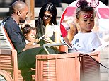 Kim Kardashian and Kanye West take yuoung daughter North on the Tow Mater Ride. as they are spotted celebrating her 2nd birthday at Disneyland in Anaheim, Ca  Pictured: Kanye West, North West and Kim Kardashian Ref: SPL1053608  150615   Picture by: GoldenEye /London Entertainment  Splash News and Pictures Los Angeles: 310-821-2666 New York: 212-619-2666 London: 870-934-2666 photodesk@splashnews.com