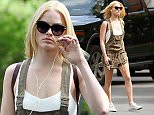 138723, EXCLUSIVE: Margot Robbie spotted walking to a hair appointment in Toronto on her day off from filming. The actress wore a loose brown overall romper paired with a stylish square backpack. Toronto, Canada - Monday June 15, 2015. CANADA OUT Photograph: © PacificCoastNews. Los Angeles Office: +1 310.822.0419 sales@pacificcoastnews.com FEE MUST BE AGREED PRIOR TO USAGE