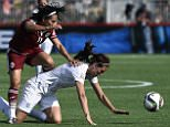 England's midfielder Jill Scot (R) falls next to Mexico's midfielder Monica Ocampo during a Group F match at the 2015 FIFA Women's World Cup between England and Mexico at Moncton Stadium, New Brunwick on June 13, 2015. AFP PHOTO / FRANCK FIFEFRANCK FIFE/AFP/Getty Images