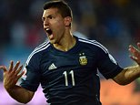 Argentina's forward Sergio Aguero celebrates after scoring against Uruguay during their 2015 Copa America football championship match, in La Serena, Chile, on June 16, 2015.  AFP PHOTO / MARTIN BERNETTIMARTIN BERNETTI/AFP/Getty Images