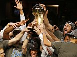 CLEVELAND, OH - JUNE 16:  The Golden State Warriors celebrates with the Larry O'Brien NBA Championship Trophy after winning Game Six of the 2015 NBA Finals against the Cleveland Cavaliers at Quicken Loans Arena on June 16, 2015 in Cleveland, Ohio. NOTE TO USER: User expressly acknowledges and agrees that, by downloading and or using this photograph, user is consenting to the terms and conditions of Getty Images License Agreement.  (Photo by Ezra Shaw/Getty Images)