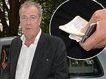 EXCLUSIVE ALL ROUND PICTURE: PALACE LEE / MATRIXPICTURES.CO.UK PLEASE CREDIT ALL USES WORLD RIGHTS English broadcaster, journalist and writer Jeremy Clarkson is pictured hopping out of a taxi with a wad of cash in the Soho area of London. Looks like the former Top Gear presenter is all set for a fun evening out in the famously debaucherous neighbourhood! JUNE 16th 2015 REF: LTN 151936