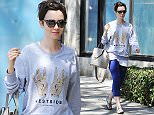 Picture Shows: Lily Collins  June 16, 2015    'Love, Rosie' actress Lily Collins is spotted at a CVS in Los Angeles, California. The daughter of Phil Collins was showing love to California with a 'West Side' shirt.    Exclusive All Rouner  UK RIGHTS ONLY  Pictures by : FameFlynet UK © 2015  Tel : +44 (0)20 3551 5049  Email : info@fameflynet.uk.com