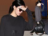 Kendall Jenner flying in a Yeezus sweatshirt and carrying a Givenchy tote valued at over $2,000. The reality star model wearing no make up was trying to hide pimples on her face and her freckles  June 15, 2014 X17online.com\nOK FOR WEB SITE USAGE AT 30PP\nMAGAZINES NORMAL FEES\nAny queries call X17 UK Office /0034 966 713 949/926 \nAlasdair 0034 630576519 \nGary 0034 686421720\nLynne 0034 611100011