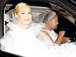 **NO Australia, New Zealand** *EXCLUSIVE* West Hollywood, CA - Part 2 - Blonde popstar Iggy Azalea and British funny man James Corden share a funny moment with our cameras while shooting a segment for a music video on Robertson Blvd, right after the sunset, both wearing a wedding gown!\n\nAKM-GSI       June 15, 2015\n\n**NO Australia, New Zealand**\n\nTo License These Photos, Please Contact :\n\nSteve Ginsburg\n(310) 505-8447\n(323) 423-9397\nsteve@akmgsi.com\nsales@akmgsi.com\n\nor\n\nMaria Buda\n(917) 242-1505\nmbuda@akmgsi.com\nginsburgspalyinc@gmail.com
