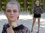 British Model Cara Delevingne attends the photocall for the movie Paper Towns (La Face Cachee de Margo) in Paris, France, Wednesday, June 17, 2015. (AP Photo/Jacques Brinon)