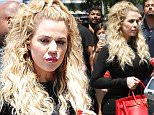 Picture Shows: Khloe Kardashian  June 16, 2015    Reality star Khloe Kardashian is spotted at her DASH store in West Hollywood, California. Khloe carried a bright red Hermes Birkin bag.    Non Exclusive  UK RIGHTS ONLY    Pictures by : FameFlynet UK © 2015  Tel : +44 (0)20 3551 5049  Email : info@fameflynet.uk.com