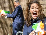 Emmy Rossum and Michael Strahan have a water fight with water guns outside 'Live! With Kelly And Michael' in New York City, New York.\n\nPictured: Michael Strahan\nRef: SPL1056459  170615  \nPicture by: Felipe Ramales / Splash News\n\nSplash News and Pictures\nLos Angeles: 310-821-2666\nNew York: 212-619-2666\nLondon: 870-934-2666\nphotodesk@splashnews.com\n