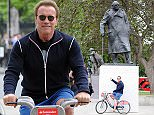 (EXCLUSIVE ALLROUND £500.00 FOR THE SET - PAPERS ONLY- NO ONLINE USAGE) Arnold Schwarzenegger goes sight-seeing in London on a Boris bike. The Terminator actor, wearing a gym top, blue shorts and vans pedaled his way around London's landmarks. Stopping off to take photographs infront of an underground sign and selfies with police officers on route and even posing infront of Sir Winston Churchills statue in Parliament square. UK. 17/06/2015..BYLINE MUST READ : GOTCHAIMAGES.COM....Copyright by © Gotcha Images Ltd. All rights reserved...Usage of this image is conditional upon the acceptance ..of Gotcha Images Ltd, terms and conditions available at..www.gotchaimages.com