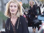 Please contact X17 before any use of these exclusive photos - x17@x17agency.com   Rosie Huntington-Whiteley bueatiful on and off the runway getting dropped off by a friend wearing a blouse and black jeans. June 16, 2015  X17online.com