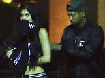 EXCLUSIVE: Kylie Jenner and Tyga were spotted walking back to their car after a late night movie date in Woodland Hills, CA. The couple arrived at around 10 pm, got the whole theater to themselves, and watched the new Jurassic World. They were seen cuddling in the back of the theater and munching on some popcorn. On their way out of the theater Tyga was seen fixing Kylie's shirt or bra strap.  Pictured: Kylie Jenner, TYGA Ref: SPL1055906  170615   EXCLUSIVE Picture by: Sharpshooter Images / Splash   Splash News and Pictures Los Angeles: 310-821-2666 New York: 212-619-2666 London: 870-934-2666 photodesk@splashnews.com