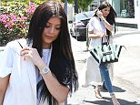 June 17, 2015\n \n Reality star Kylie Jenner is spotted visiting Fred Segal in West Hollywood, California with a friend. Kylie was looking chic in a long white vest over a white t-shirt, blue skinny jeans, grey sandals, and a striped Celine purse.\n \n Non Exclusive\n UK RIGHTS ONLY\n \n Pictures by : FameFlynet UK © 2015\n Tel : +44 (0)20 3551 5049\n Email : info@fameflynet.uk.com