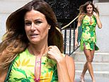 """eURN: AD*172822993  Headline: Kelly Bensimon goes Gang Green in NYC Caption: New York, NY - Kelly Bensimon steps out with a male friend looking green with envy dressed in a printed green dress and green E. Goyard tote.  The """"Real Housewives of New York"""" star stopped to pose for a quick photo-op with her male friend, presumably for a later social media post. AKM-GSI       June 17, 2015 To License These Photos, Please Contact : Steve Ginsburg (310) 505-8447 (323) 423-9397 steve@akmgsi.com sales@akmgsi.com or Maria Buda (917) 242-1505 mbuda@akmgsi.com ginsburgspalyinc@gmail.com Photographer: AKED JAXN  Loaded on 18/06/2015 at 00:31 Copyright:  Provider: AKM-GSI  Properties: RGB JPEG Image (8976K 1832K 4.9:1) 1429w x 2144h at 300 x 300 dpi  Routing: DM News : GeneralFeed (Miscellaneous) DM Showbiz : SHOWBIZ (Miscellaneous) DM Online : Online Previews (Miscellaneous), CMS Out (Miscellaneous)  Parking:"""