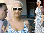 EXCLUSIVE: Amber Rose was spotted out running errands in West Hollywood wearing a tight fitting $100 dollar bill money printed dress. The ex wife of Wiz Khalifa also playfully flicked her middle finger at the cameras.  Pictured: Amber Rose Ref: SPL1056246  170615   EXCLUSIVE Picture by: Sharpshooter Images / Splash   Splash News and Pictures Los Angeles: 310-821-2666 New York: 212-619-2666 London: 870-934-2666 photodesk@splashnews.com