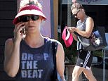 """UK CLIENTS MUST CREDIT: AKM-GSI ONLY\nEXCLUSIVE: Kaley Cuoco gets in a workout today and later visits My Nail Couture to get her nails done.  Haley rocked a cute tank top that read """"drop the beat"""" and wide-brim pink visor to be incognito.\n\nPictured: Kaley Cuoco\nRef: SPL1056975  170615   EXCLUSIVE\nPicture by: AKM-GSI / Splash News\n\n"""