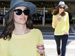 Emmy Rossum was spotted in a blod yellow sweater and jeans, enjoying a refreshing Starbucks after her flight, on Thursday, June 18, 2015  X17online.com