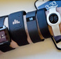 FILE - In this Dec. 15, 2014 file photo, fitness trackers, from left, Basis Peak, Adidas Fit Smart, Fitbit Charge, Sony SmartBand, and Jawbone Move, are posed for a photo next to an iPhone, in New York. Sales of fitness trackers are climbing, and the biggest maker of the gadgets, Fitbit, made a splashy debut on the stock market Thursday, June 18, 2015. (AP Photo/Bebeto Matthews, File)