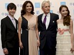 Actor Michael Douglas (2nd R), his wife Catherine Zeta Jones, son Dylan and daughter Carys, pose for a photograph upon their arrival for the Genesis Prize award ceremony in Jerusalem June 18, 2015. Israeli Prime Minister Benjamin Netanyahu will award the Genesis Prize of $1 million to Douglas on Thursday. The prize is organised by Israel's Prime Minister Office, the Genesis Philanthropy Group, and the Jewish Agency for Israel. REUTERS/Debbie Hill/Pool