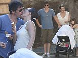 """18 giu 2015 - ROME - ITALY  *** NOT AVAILABLE FOR ITALY ***  FORMER MODEL AND ACTRESS MILLA JOVOVICH IN ROME TO STAR INT BEN STILLER'S """"ZOOLANDER 2"""" IS SPOTTED HAVING A DAY OFF FROM THE SET WITH HER HUSBAND DIRECTOR PAUL W.S. ANDERSON THEIR DAUGHTERS EVER GABO J. ANDERSON AND 3 MONTHS OLD DASHIEL EDON ANDERSON AND MILLA'S MOM GALINA JOVOVICH, THEY ENJOY AN ICE CREAM THEN LET HER DAUGHTER EVER PLAYING IN A FOUNTAIN AND FINALLY THEY STOP TO TAKE A SELFIE WITH ROME'S SKYLINE IN BACKGROUND   BYLINE MUST READ : XPOSUREPHOTOS.COM  ***UK CLIENTS - PICTURES CONTAINING CHILDREN PLEASE PIXELATE FACE PRIOR TO PUBLICATION ***  **UK CLIENTS MUST CALL PRIOR TO TV OR ONLINE USAGE PLEASE TELEPHONE 44 208 344 2007**"""