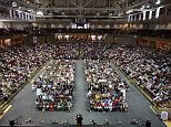 CHARLESTON, SC - JUNE 19:  Thousands of people gather for a city-sponsored prayer vigil for the nine victims of the Emanuel AME Church shooting at the College of Charleston TD Arena June 19, 2015 in Charleston, South Carolina. Authorities arrested Dylann Storm Roof, 21, after he allegedly attended a prayer meeting at the church for an hour before opening fire and killing three men and six women. Among the dead is the Rev. Clementa Pinckney, a state senator and a pastor at the church, the oldest black congregation in America south of Baltimore, according to the National Park Service.  (Photo by Chip Somodevilla/Getty Images)