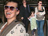 19 Jun 2015 - LOS ANGELES - USA  MILLA JOVOVICH WITH FAMILY AND NEW BORN BABY BACK FROM ITALY VACATION AT LAX AIRPORT.   BYLINE MUST READ : XPOSUREPHOTOS.COM  ***UK CLIENTS - PICTURES CONTAINING CHILDREN PLEASE PIXELATE FACE PRIOR TO PUBLICATION ***  **UK CLIENTS MUST CALL PRIOR TO TV OR ONLINE USAGE PLEASE TELEPHONE  44 208 344 2007 ***