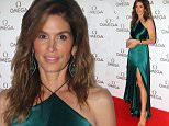 US model Cindy Crawford poses as she arrives to attend a promotional event in Mumbai late June 18, 2015. AFP PHOTO/STRSTRDEL/AFP/Getty Images
