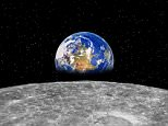 A picture showing planet Earth and Moon.  Earth rising over Moon