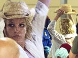 18.JUNE.2015 - LOS ANGELES - USA\n*** AVAILABLE FOR UK SALE ONLY ***\nBRITNEY SPEARS MAYBE ONE OF THE BIGGEST POP STARS IN THE WORLD BUT LEARNED WHEN GOING THROUGH THE AIRPORT SHE GETS THE SAME TREATMENT AS EVERYONE ELSE AS SHE IS MADE TO GO THROUGH TWO DIFFERENT SCREENING DEVICES.  BRITNEY HAD TO REMOVE HER HEELS, HAT AND GLASSES AS SHE CONTINUED TO TRIGGER THE ALARMS MUCH TO HER ANNOYANCE.  BRITNEY WAS TRAVELING WITH HER TWO SONS, SEAN PRESTON AND JAYDEN JAMES, WHO WAS CARRYING A STAR WARS STORM TROOPER ACTION FIGURE AND WAS GLAD TO SHOW TO PHOTOGRAPHERS.\nBYLINE MUST READ : XPOSUREPHOTOS.COM\n***UK CLIENTS - PICTURES CONTAINING CHILDREN PLEASE PIXELATE FACE PRIOR TO PUBLICATION ***\n*UK CLIENTS MUST CALL PRIOR TO TV OR ONLINE USAGE PLEASE TELEPHONE 0208 344 2007*