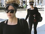 Please contact X17 before any use of these exclusive photos - x17@x17agency.com   Khloe Kardashian rocks her black bandana while hitting up SoulCycle for an intense sweat session. June 19, 2015 X17online.com EXCLUSIVE