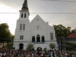 A crowd gathers outside the Emanuel African Methodist Episcopal Church following a prayer vigil nearby in Charleston, South Carolina, June 19, 2015, two days after a mass shooting left nine dead during a bible study at the church.     REUTERS/Brian Snyder
