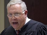 Judge James Gosnell speaks during a bond hearing for Dylann Roof who appeared in a video feed from jail in North Charleston, S.C. June 19, 2015.  Roof has been charged with nine counts of murder in connection with an attack on a historic black South Carolina church, police said on Friday, and media reports said he had hoped to incite a race war in the United States.   Grace Beahm/The Post and Courier/Pool