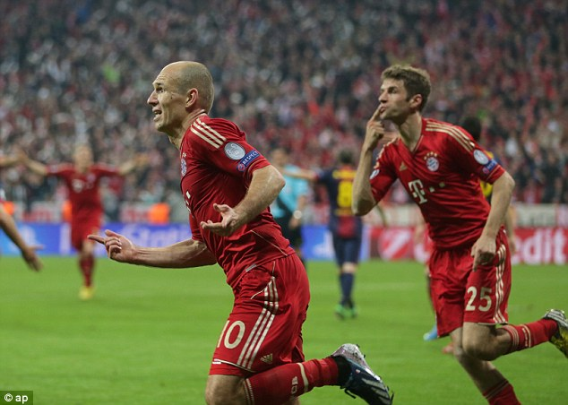 Brutal: Thomas Muller (right) and Arjen Robben (left) put Barcelona to the sword in a crushing win