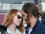 EXCLUSIVE: Emma Stone and Andrew Garfield get close while pumping gas in Santa Monica, California.  Pictured: Andrew Garfield and Emma Stone Ref: SPL1058780  200615   EXCLUSIVE Picture by: WEBB / Splash News  Splash News and Pictures Los Angeles: 310-821-2666 New York: 212-619-2666 London: 870-934-2666 photodesk@splashnews.com