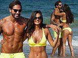 ***** NOTE TO PIC DESK ***** £200 MIN USAGE FEE FOR ONLINE ***** £150 PER PIC IN PRINT ***** PIC FROM MERCURY PRESS (PICTURED - MARIO AND EMMA STROLLING ALONG THE BEACH IN PORTUGAL) TOWIE hunk Mario Falcone and long-term lover Emma McVey were looking not so mellow in yellow as the frolicked on the beach. The tanned couple, who have been dating since November last year, were seen making the most of a recent getaway in Lagos, Portugal, last week. Mario, 27, and model Emma, 26, looked smitten as they locked lips in the sand - seemingly putting to bed split rumours which rocked the relationship back in May. And the Essex lothario showed off his impressive physique in a tiny pair of swim shorts - after he was suspended by the ITV realtiy show for promoting weight loss pills. SEE MERCURY COPY