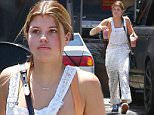 Picture Shows: Sofia Richie  June 20, 2015\n \n Nicole Richie's little sister, Sofia Richie and some friends returning some surfboards after a surfing lesson in Malibu, California. Before returning the surfboards Sofia stopped to grab a couple of iced coffees. \n \n EXCLUSIVE ALL ROUNDER\n UK RIGHTS ONLY\n \n Pictures by : FameFlynet UK © 2015\n Tel : +44 (0)20 3551 5049\n Email : info@fameflynet.uk.com