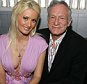 Holly Madison and Hugh Hefner during Playboy and Stoli Celebrate the Season 2 DVD Release of The Girls Next Door at Stoli Hotel Hollywood in Hollywood, California, United States. (Photo by Michael Bezjian/WireImage)