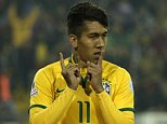SANTIAGO, CHILE - JUNE 21: Roberto Firmino of Brazil celebrates after scoring the second goal of his team during the 2015 Copa America Chile Group C match between Brazil and Venezuela at Monumental David Arellano Stadium on June 21, 2015 in Santiago, Chile. (Photo by Claudio Santana/LatinContent/Getty Images)