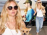 Jennifer Lawrence dresses down in a white tank and baggy denim while wearing NO MAKE UP. The Hunger Games star arrives at LAX to catch a flight with her pup, June 24, 2015 X17online.com