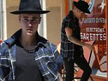 """UK CLIENTS MUST CREDIT: AKM-GSI ONLY\nEXCLUSIVE: Part 2 - Justin Bieber was spotted stopping at a car rental place before shopping for electronic cigarettes on Wednesday afternoon as he headed into The Vapor Shop in Westwood. The """"Baby"""" hitmaker cruised out of a huge SUV and rocked a work pie hat, ripped sleeve plaid shirt and blue slip on sneakers as he entered the store.\n\nPictured: Justin Bieber\nRef: SPL1062199  240615   EXCLUSIVE\nPicture by: AKM-GSI / Splash News\n\n"""