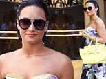 Demi Lovato wears colorful print onesie dress while greeting fans outside Z100 studios in New York City.\n\nPictured: Demi Lovato\nRef: SPL1062366  250615  \nPicture by: Splash News\n\nSplash News and Pictures\nLos Angeles: 310-821-2666\nNew York: 212-619-2666\nLondon: 870-934-2666\nphotodesk@splashnews.com\n