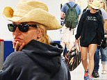EXCLUSIVE: Britney Spears leaves New Orleans following news of her split with boyfriend Charlie Ebersol. The pop star kept a low profile at the airport in short shorts, sunglasses and a straw cowboy hat.\n\nPictured: Britney Spears\nRef: SPL1061019  240615   EXCLUSIVE\nPicture by: Splash News\n\nSplash News and Pictures\nLos Angeles: 310-821-2666\nNew York: 212-619-2666\nLondon: 870-934-2666\nphotodesk@splashnews.com\n